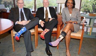 Stephen Hadley, Bob Gates and Condi Rice celebrate George H.W. Bush's birthday with these splashy socks.