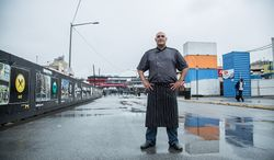 Faisal Sultani, Executive Chef & Owner of Clubhouse Cuisine, poses for a photograph outside of Nationals Ball Park in Washington, DC., Friday June 7, 2013.  (Andrew S Geraci/The Washington Times)