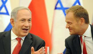 Prime Ministers Benjamin Netanyahu (left) of Israel and Donald Tusk of Poland talk before a meeting between members of their governments in Warsaw on Wednesday, June 12, 2013. Mr. Netanyahu was in Poland for a two-day visit for talks with Mr. Tusk and the opening of a Holocaust exhibition at the Auschwitz-Birkenau Nazi death camp. (AP Photo/Alik Keplicz)