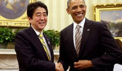 ** FILE ** In this Feb. 22, 2013, file photo, President Barack Obama shakes hands with Japan's Prime Minister Shinzo Abe in the Oval Office of the White House in Washington. (AP Photo/Charles Dharapak, File)