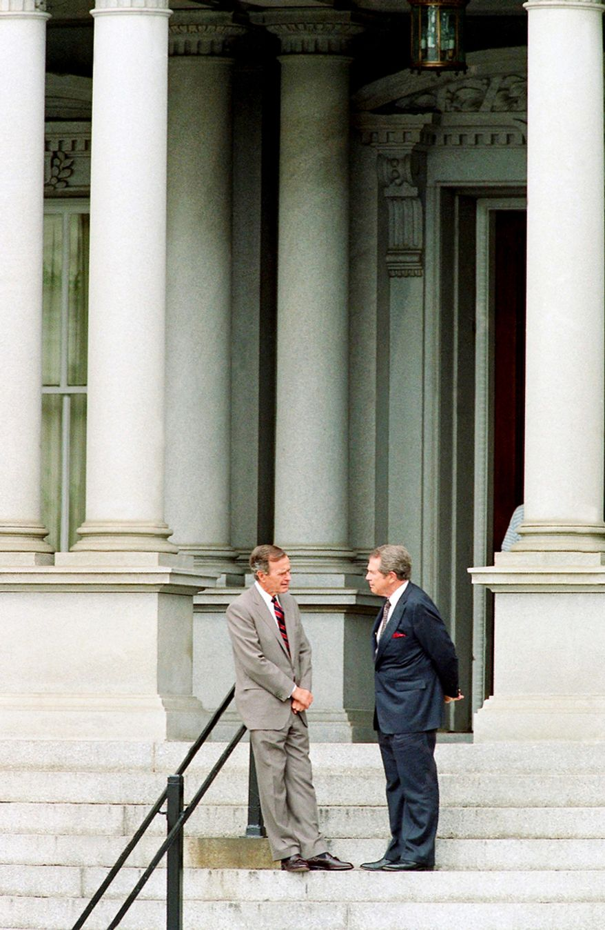 ** FILE ** U.S. President George H. Bush, left, stops to chat with evangelist Pat Robertson on the stops of the Old Executive Office Building in Washington, Thursday, July 23, 1992. Bush was at the Old Executive Office Building, located next to the White House, to tape an interview with Robertson. (AP Photo/Doug Mills)