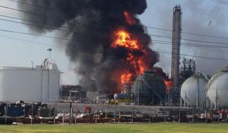 A fire rages after an explosion at The Williams Companies plant in the Ascension Parish town of Geismar, La., on Thursday, June 13, 2013. The company's website says the firm puts out about 1.3 billion pounds of ethylene and 90 million pounds of polymer-grade propylene a year. (AP Photo/Ryan Meador)