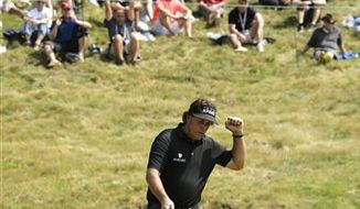 Phil Mickelson reacts after his birdie putt on the ninth hole during the first round of the U.S. Open golf tournament at Merion Golf Club, Thursday, June 13, 2013, in Ardmore, Pa. (AP Photo/Charlie Riedel)