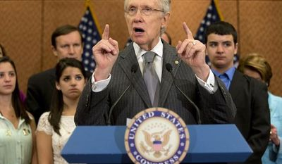 Senate Majority Leader Harry Reid, Nevada Democrat, accompanied by families and friends of the Newtown, Conn., shooting victims, including (from left) Jillian, Carlee and Carlos Soto, siblings of Victoria Soto, speaks during a news conference on Capitol Hill on June 13, 2013, the six-month anniversary of the Newtown shooting. (Associated Press)