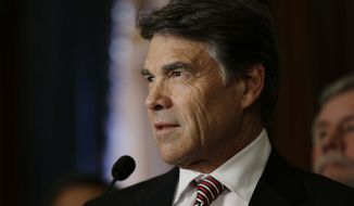 ** FILE ** Texas Gov. Rick Perry speaks during a ceremonial signing of a water fund bill on Tuesday, May 28, 2013, in Austin, Texas. (AP Photo/Eric Gay)