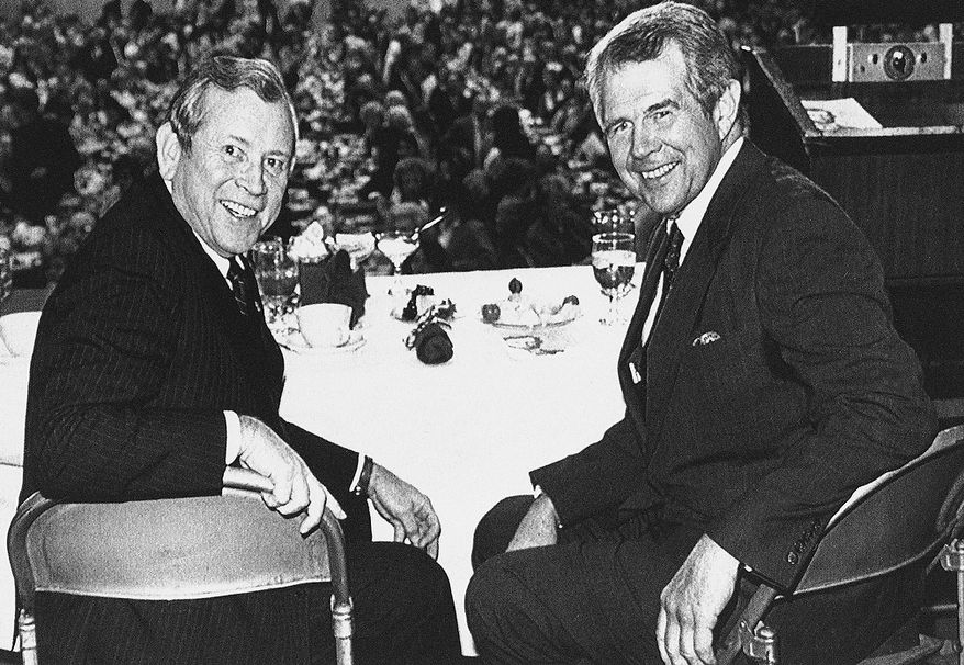 Former U.S. Senator Howard Baker of Tennessee, left, and evangelist Pat Robertson, both expected presidential candidates in 1988 attended Lincoln Day dinner in Knoxville, Tennessee on Thursday, Feb. 12, 1987. (AP Photo/Mark Crosten)