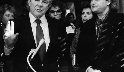 Presidential hopeful Pat Robertson makes an appearance with country music star Ricky Skaggs as Robertson visits his campaign headquarters in Nashville, Tenn., Jan. 12, 1988. (AP Photo/Mark Humphrey)