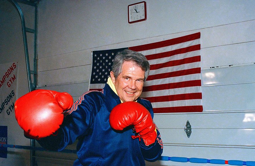 Pat Robertson, a former Golden Gloves champion, puts on the gloves at Sampson?s Gym, Monday, Feb. 15, 1988 in Manchester, N.H., for a couple of rounds with Mike Sampson. The Republican presidential hopeful went the distance and called the fight a draw. The New Hampshire primary is Tuesday. (AP Photo/Pat Wellenbach)