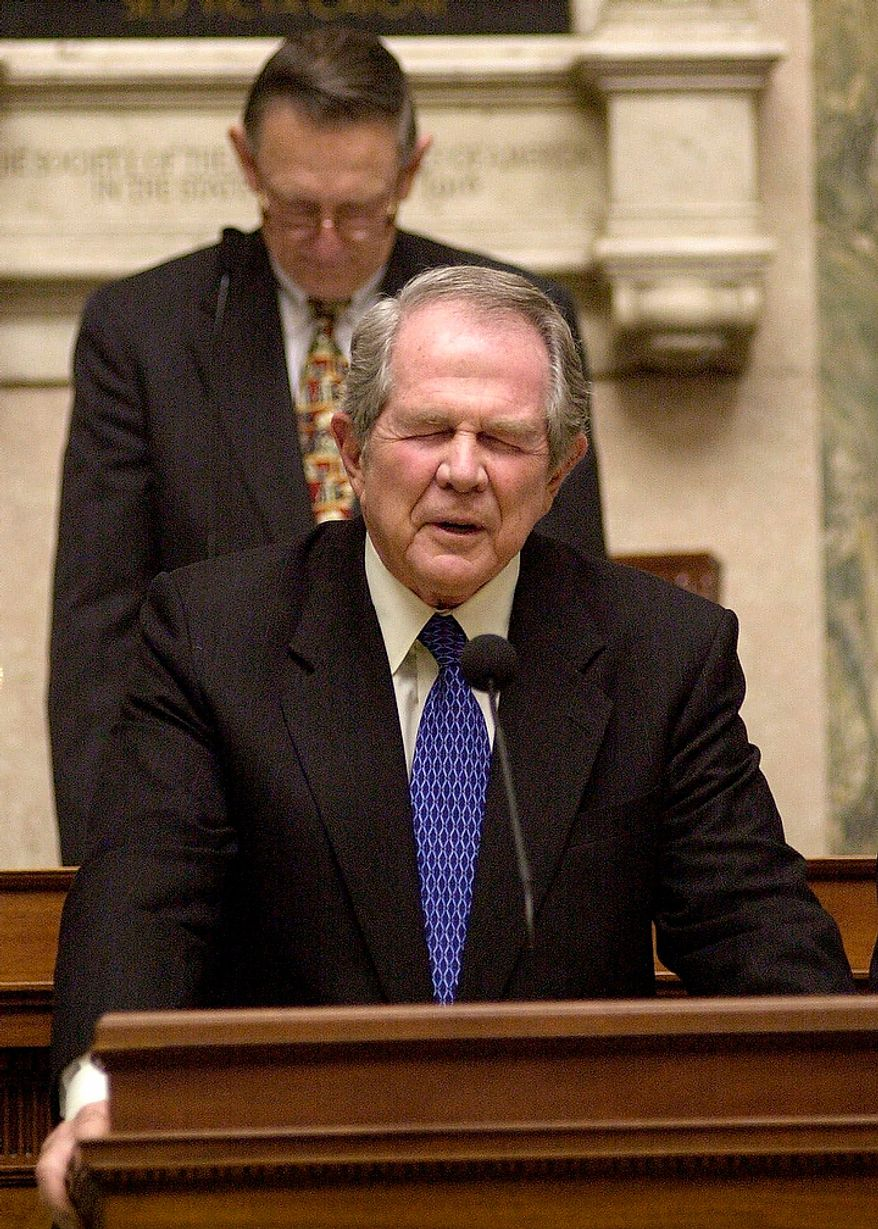 Religious broadcaster Pat Robertson, of Virignia Beach, leads the House in prayer along with House Speaker Vance Wilkins, R-Amherst, backround at the Capitol in Richmond, Va., Thursday, Feb. 15, 2001.  (AP Photo/Steve Helber)