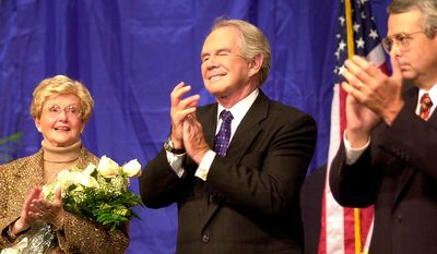 "Pat Robertson, center, the founder of the Christian Broadcasting Network,  his wife, Adelia ""Dede"" Robertson, left, and Michael D. Little, right, the president and chief operating officer of CBN, applaud during celebrations marking the 40th anniversary of the on the air debut of the network.  (AP Photo/Gary C. Knapp)"