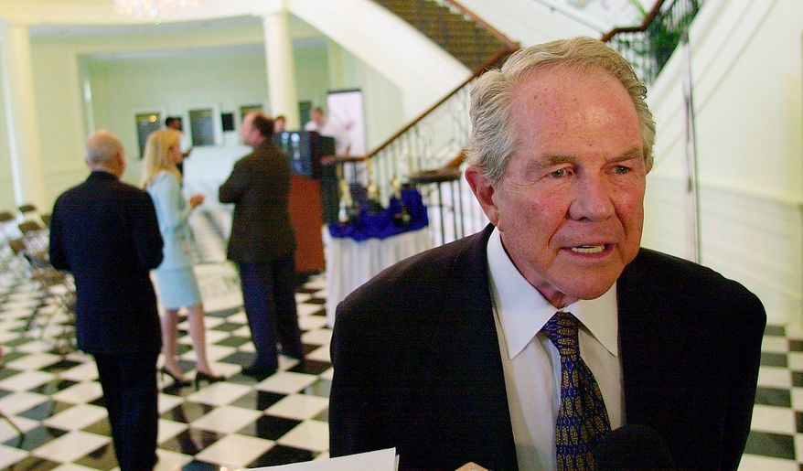 Pat Robertson, the founder of the 700 Club, Regent University and the Christian Broadcasting Network (CBN), talks to reporters Thursday, July 17, 2003 in Virginia Beach, Va. Robertson says he was not talking about any particular liberal justices when he asked his national TV audience to pray for the removal of three justices. He says the departure of any three liberal justices would be fine. (AP Photo/Gary C. Knapp)
