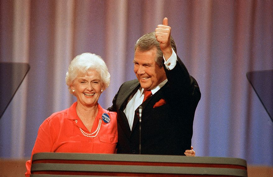 Former Republican presidential hopeful Pat Robertson gives a thumbs-up as he and his wife, Dee Dee, acknowledge applause at the Republican National Convention in New Orleans, Tuesday, August 17, 1988. (AP Photo/Ron Edmonds)