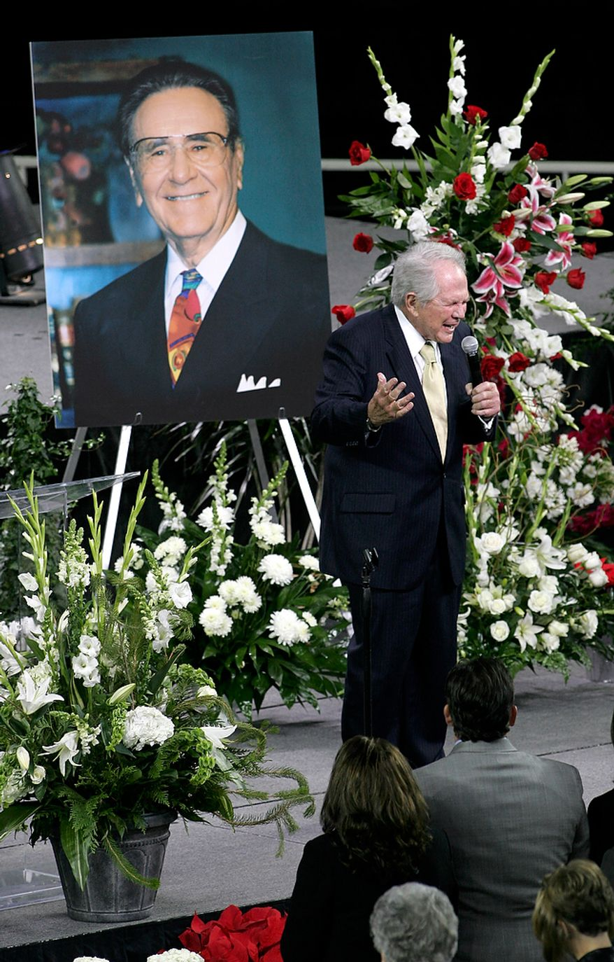 Evangelist Pat Robertson gives the opening prayer at a memorial service for evangelist Oral Roberts on the campus of Oral Roberts University on Monday, Dec. 21, 2009.  Roberts died Dec. 15 at the age of 91. (AP Photo/David Crenshaw)