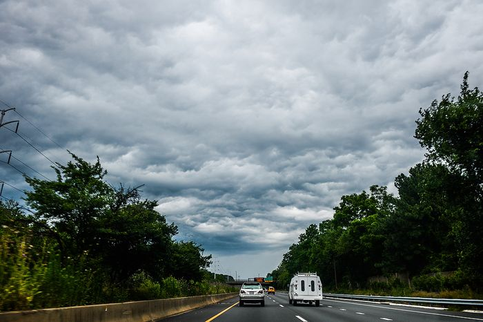 Morning storm clouds can be seen on Interstate 66, Arlington, Va., Thursday, June 13, 2013. (Andrew Harnik/The Washington Times)