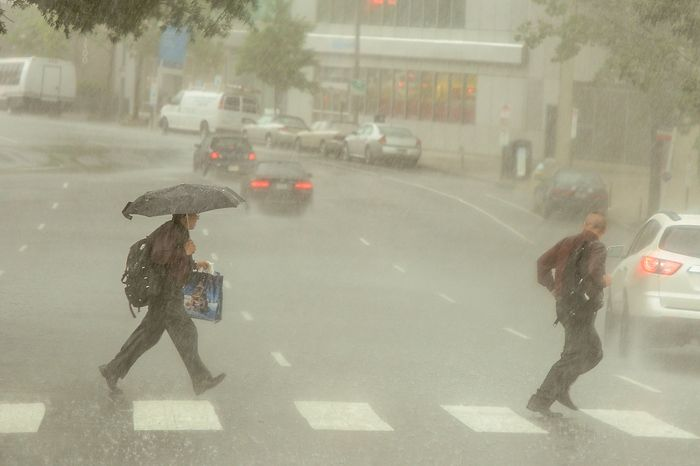 Pedestrians run for cover in Rosslyn as severe storms move through the region bringing heavy rain and winds, Arlington, Va., Thursday, June 13, 2013. (Andrew Harnik/The Washington Times)