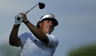 Phil Mickelson tees off on the fifth hole during the second round of the U.S. Open golf tournament at Merion Golf Club, Friday, June 14, 2013, in Ardmore, Pa. (AP Photo/Julio Cortez)