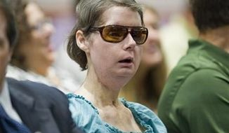 ** FILE ** Charla Nash sits before a hearing at the Legislative Office Building in Hartford, Conn., to determine whether she may sue the state for $150 million in claimed damages, Aug. 10, 2012. Nash was mauled in a 2009 chimpanzee attack. On Friday, June 14, 2013, state Claims Commissioner J. Paul Vance Jr., denied permission for Nash to sue the state because at the time of the attack, the law allowed private ownership of the animals. (Associated Press)
