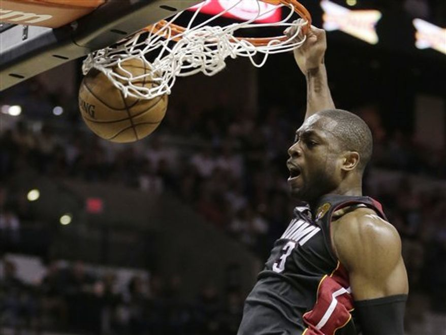 Miami Heat's Dwyane Wade (3) dunks against the San Antonio Spurs during the second half at Game 4 of the NBA Finals basketball series, Thursday, June 13, 2013, in San Antonio. (AP Photo/Eric Gay)