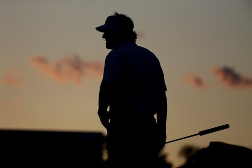 Phil Mickelson waits to putt on the 18th green during the second round of the U.S. Open golf tournament at Merion Golf Club, Friday, June 14, 2013, in Ardmore, Pa. (AP Photo/Morry Gash)