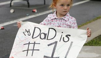 Eliza Gardner holds a sign for her dad during the Deseret News Marathon in Salt Lake City, Tuesday, July 24, 2012. (Ravell Call, Deseret News)