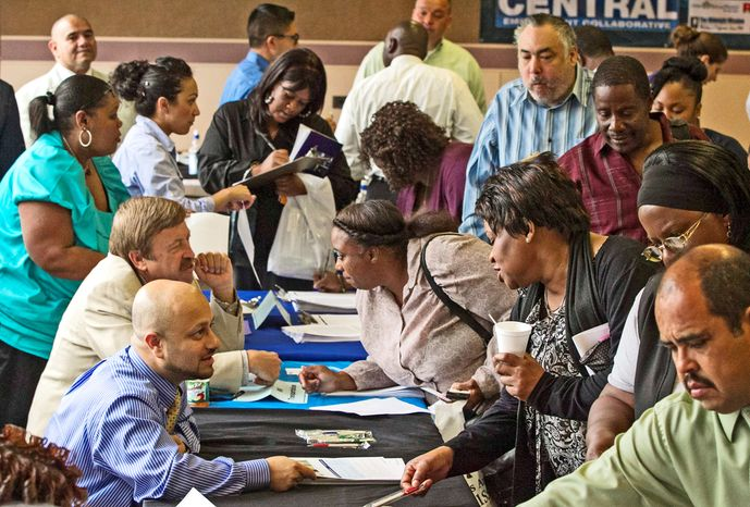 ** FILE ** Job seekers at a recent Los Angeles career fair were less likely than before the recession to find full-time work. Starting Jan. 1, larger employers must provide health