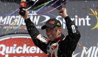Sprint Cup Series driver Greg Biffle celebrates his win in the NASCAR Quicken Loans 400 auto race at Michigan International Speedway, Sunday, June 16, 2013 in Brooklyn, Mich. (AP Photo/Carlos Osorio)