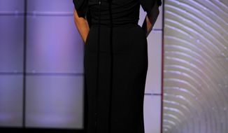 Kris Jenner presents the award for outstanding talk-show host at the 40th annual Daytime Emmy Awards on Sunday, June 16, 2013, in Beverly Hills, Calif. (Chris Pizzello/Invision/AP)