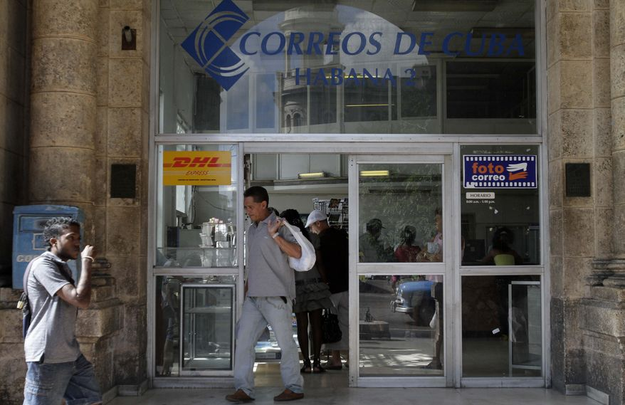 **FILE** A man leaves a postal office in Havana on Nov. 25, 2010. (Associated Press)