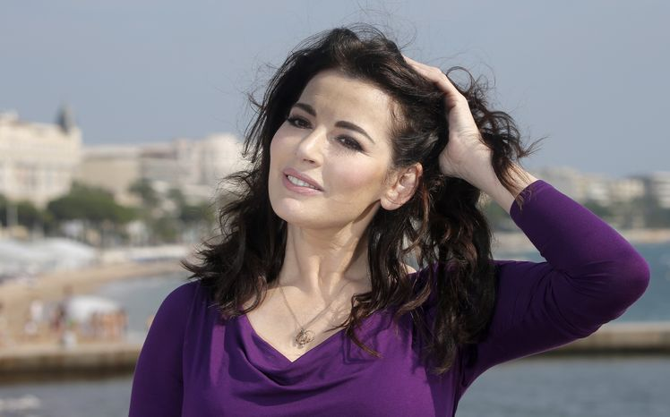 English food writer, journalist and broadcaster Nigella Lawson poses during the 28th International Film and Programme Market for TV, Video, Cable and Satellite (MIPCOM) in C