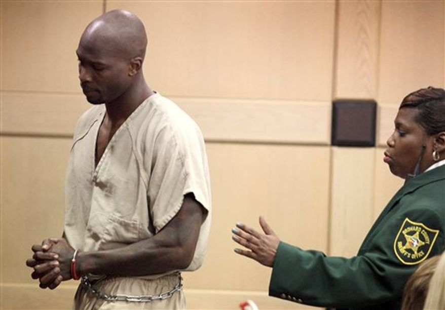 Former Miami Dolphins and NFL football star Chad Johnson, left, is waiting to appear before Broward County Circuit Judge Kathleen McHugh, Monday, June 17, 2013, in Fort Lauderdale, Fla. Johnson apologized for disrespecting the judge when he slapped his attorney on the backside in court last week, and his immediate release from jail was ordered. She accepted Johnson's apology and cut his 30-day jail term for a probation violation to the seven days he had already served. (AP Photo/Cristobal Herrera, Pool)