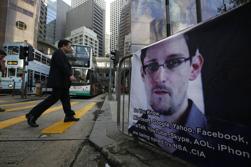 **FILE** A banner supporting Edward Snowden, a former CIA employee who leaked top-secret documents about sweeping U.S. surveillance programs, is displayed at Central, Hong Kong's business district, on June 17, 2013.  (Associated Press)