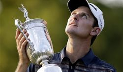 Justin Rose, of England, poses with the trophy after winning the U.S. Open golf tournament at Merion Golf Club, Sunday, June 16, 2013, in Ardmore, Pa. (AP Photo/Darron Cummings)