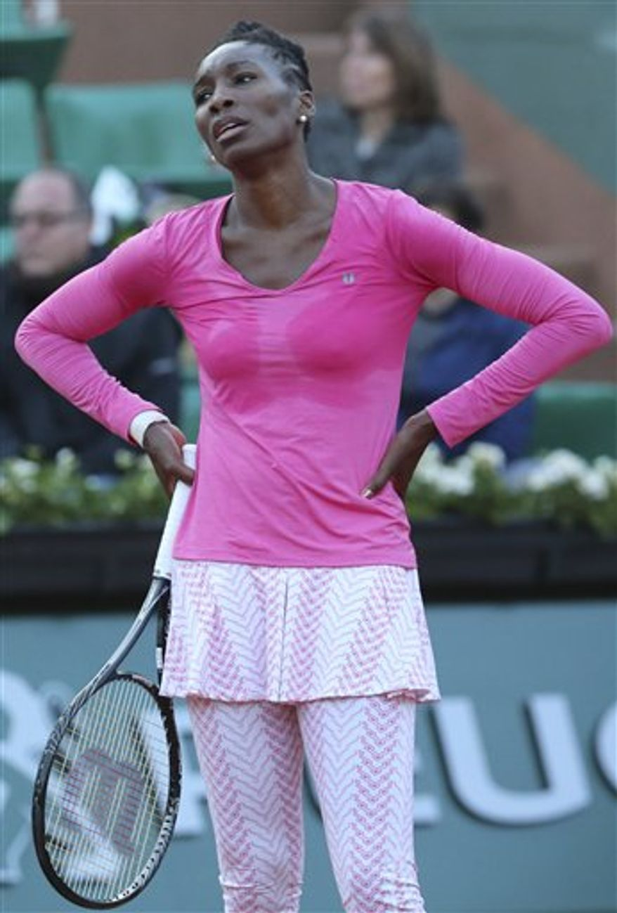 Venus Williams of the U.S. misses a return against Poland's Urszula Radwanska in their first round match of the French Open tennis tournament, at Roland Garros stadium in Paris, Sunday, May 26, 2013. Venus Williams lost in the French Open's first round for the first time since 2001, beaten 7-6 (5), 6-7 (4), 6-4 Sunday by 40th-ranked Urszula Radwanska of Poland. (AP Photo/Michel Euler)