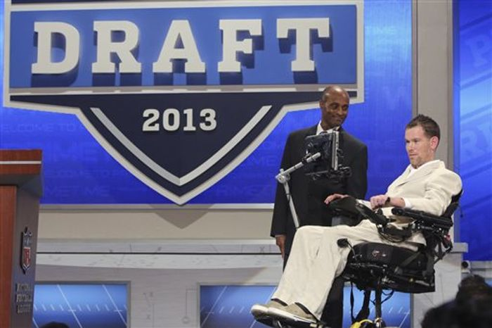 Former New Orleans Saints safety Steve Gleason announces a draft pick during the third round of the NFL Draft, Friday, April 26, 2013 at Radio City Music Hall in New York. (AP Photo/Mary Altaffer)