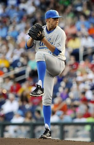 UCLA starting pitcher Nick Vander Tuig winds up to deliver against North Carolina State in the first inning of an NCAA College World Series baseball game in Omaha, Neb., Tuesday, June 18, 2013. (AP Photo/Eric Francis)