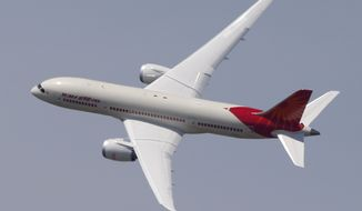 "An Air India Boeing 787 ""Dreamliner"" performs a demonstration flight during the first day of the 50th Paris Air Show at Le Bourget Airport, north of Paris, on Monday, June 17, 2013. (AP Photo/Francois Mori)"