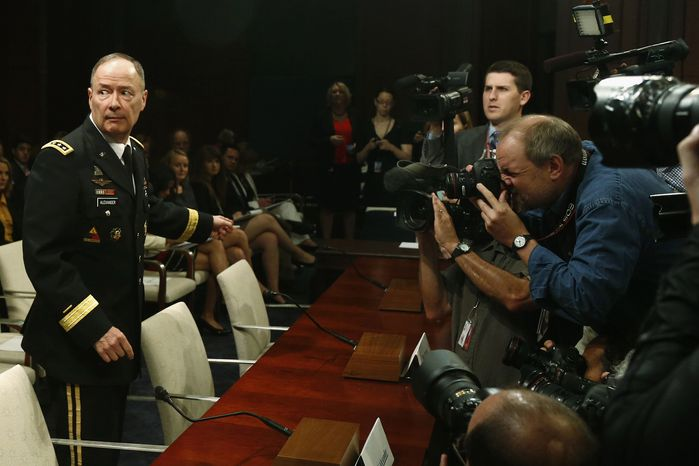 Gen. Keith B. Alexander, director of the National Security Agency, approaches the witness table on Capitol Hill in Washington on June 18, 2013, to testify before the House Intelligence Committee hearing regarding the agency's surveillance. (Associated Press)