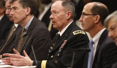 From left: Deputy Attorney General James Cole; Chris Inglis, deputy director of the National Security Agency; Gen. Keith B. Alexander, director of the National Security Agency; Sean Joyce, Deputy Director of the FBI; and Robert Litt, general counsel to the Office of the Director of National Intelligence, testify before the House Permanent Select Committee on Intelligence in Washington on June 18, 2013, regarding NSA surveillance. (Associated Press)