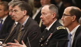 **FILE** Gen. Keith B. Alexander, commander of the U.S. Cyber Command and director of the National Security Agency, testifies on Capitol Hill in Washington on June 12, 2013. (Associated Press)