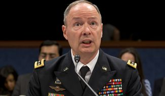 Gen. Keith B. Alexander, director of the National Security Agency and head of the U.S. Cyber Command, testifies on Capitol Hill in Washington on June 18, 2013, before the House Permanent Select Committee on Intelligence. (Associated Press)