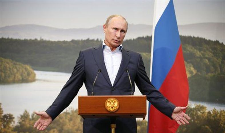 ** FILE ** Russian President Vladimir Putin gestures while speaking during a media conference after a G-8 summit at the Lough Erne golf resort in Enniskillen, Northern Ireland, on Tuesday, June 18, 2013. (Associated Press)
