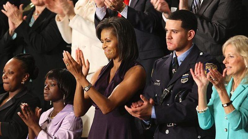 ** FILE ** Rirchard DeCoatsworth sits with first lady Michelle Obama at the president's St
