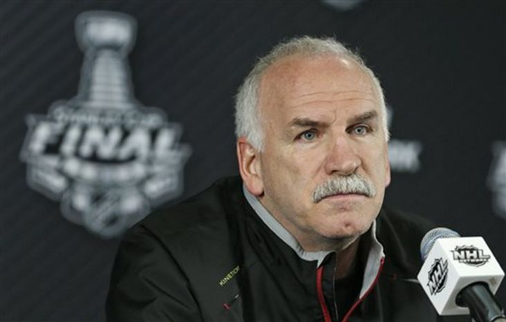 Chicago Blackhawks head coach Joel Quenneville listens to a reporter's question during a press conference in Boston, Tuesday, June 18, 2013. The Blackhawks trail the Boston Bruins 2-1 in the best-of-seven series in the Stanley Cup Finals. Game 4 is scheduled for Wednesday in Boston. (AP Photo/Charles Krupa)