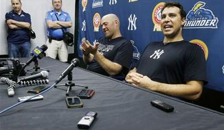 **FILE** New York Yankees general manager Brian Cashman, left, and third baseman Kevin Youkilis, center, listen as first baseman Mark Teixeira, right, answers a question during a news conference in Trenton, N.J., Wednesday, May 29, 2013, after Youkilis and Teixeira played a rehab game with the Trenton Thunder. Teixeira has been sidelined with a right wrist injury since March, and Youkilis has missed nearly 30 games with a back injury. (AP Photo/Mel Evans)