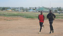 A young athlete joins Guor Mading for a jog in Juba, the capital of South Sudan. (Photograph provided by U.N. High Commissioner for Refugees)