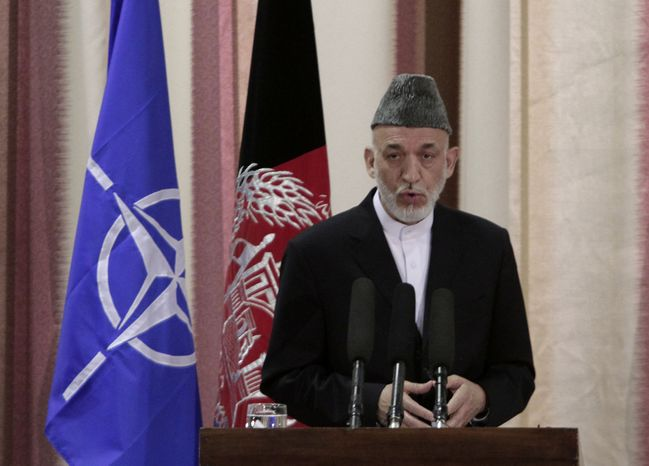 Afghan President Hamid Karzai speaks during a ceremony at military academy on the outskirts of Kabul, Afghanistan, on Tuesday, June 18, 2013. Mr. Karzai announced at the event that his country's armed forces are taking over the lead for se