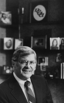 **FILE** NCAA director Walter Byers poses in his NCAA office in Mission, Kansas, Dec. 1, 1986. (AP Photo/Cliff Schiappa)
