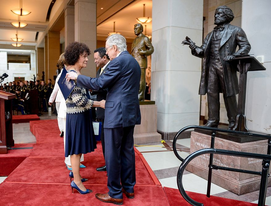 Nettie Washington Douglass, Frederick Douglass' great great granddaughter, left, talks with Senate Majority Leader Harry Reid (D-Nev.) after speaking at a congressional ceremony to commemorate the dedication and unveiling of a statue of Frederick Douglass in Emancipation Hall of the the United States Visitors Center, Washington, D.C., Wednesday, June 19, 2013. (Andrew Harnik/The Washington Times)