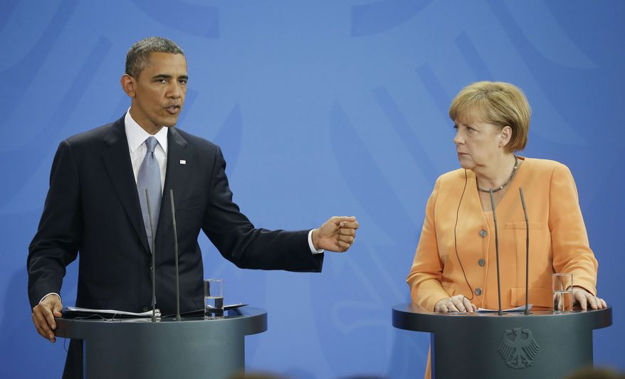 U.S. President Barack Obama and German Chancellor Angela Merkel meet during their joint news conference at the Chancellery in Berlin, Germany, Wednesday, June 19, 2013. Obama will renew his call to reduce the world's nuclear stockpiles, including a proposed one-third reduction in U.S. and Russian arsenals, a senior administration official said. (AP Photo/Pablo Martinez Monsivais)