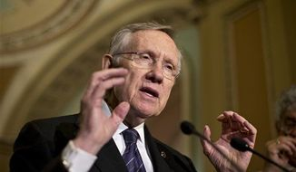 Senate Majority Leader Harry Reid, Nevada Democrat, speaks with reporters following a Democratic strategy session at the Capitol in Washington on Tuesday, June 18, 2013. (Associated Press)